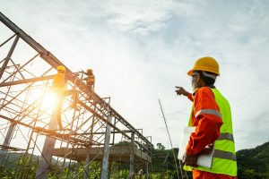 A man overseeing steel construction work
