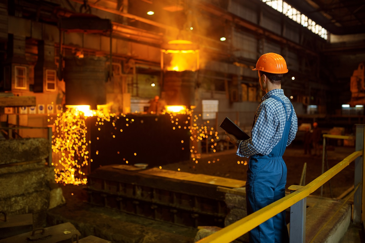 Master steelmaker at furnace, steel factory