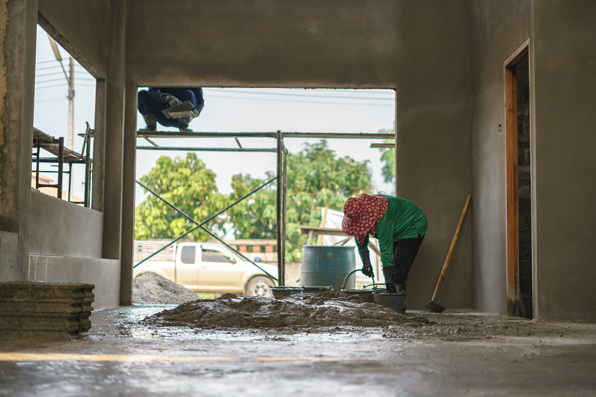 Asian worker labor working with concrete cement
