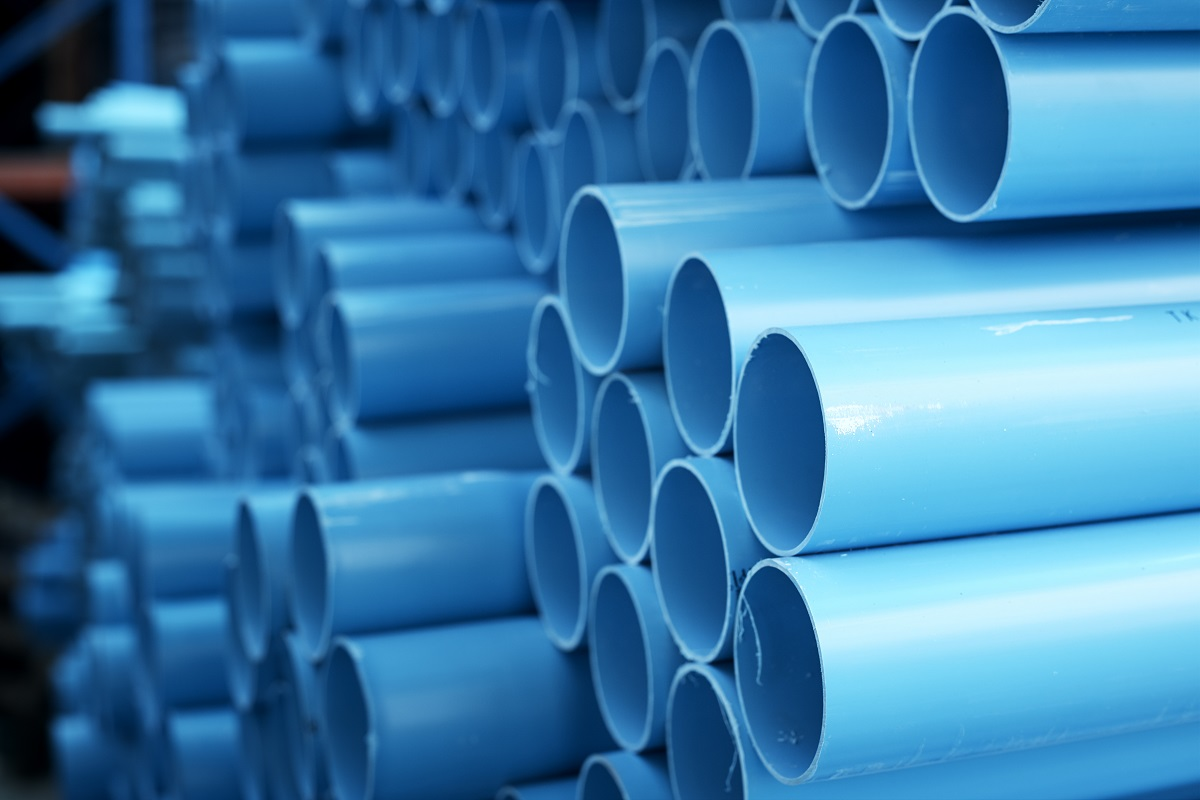 Blue PVC pipes stacked in construction site
