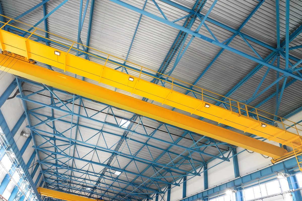 Blue steel frame of metal industrial roof in warehouse with yell